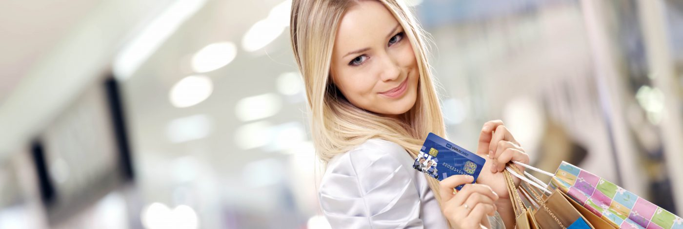 Shopping blonde with plastic card Variuscard